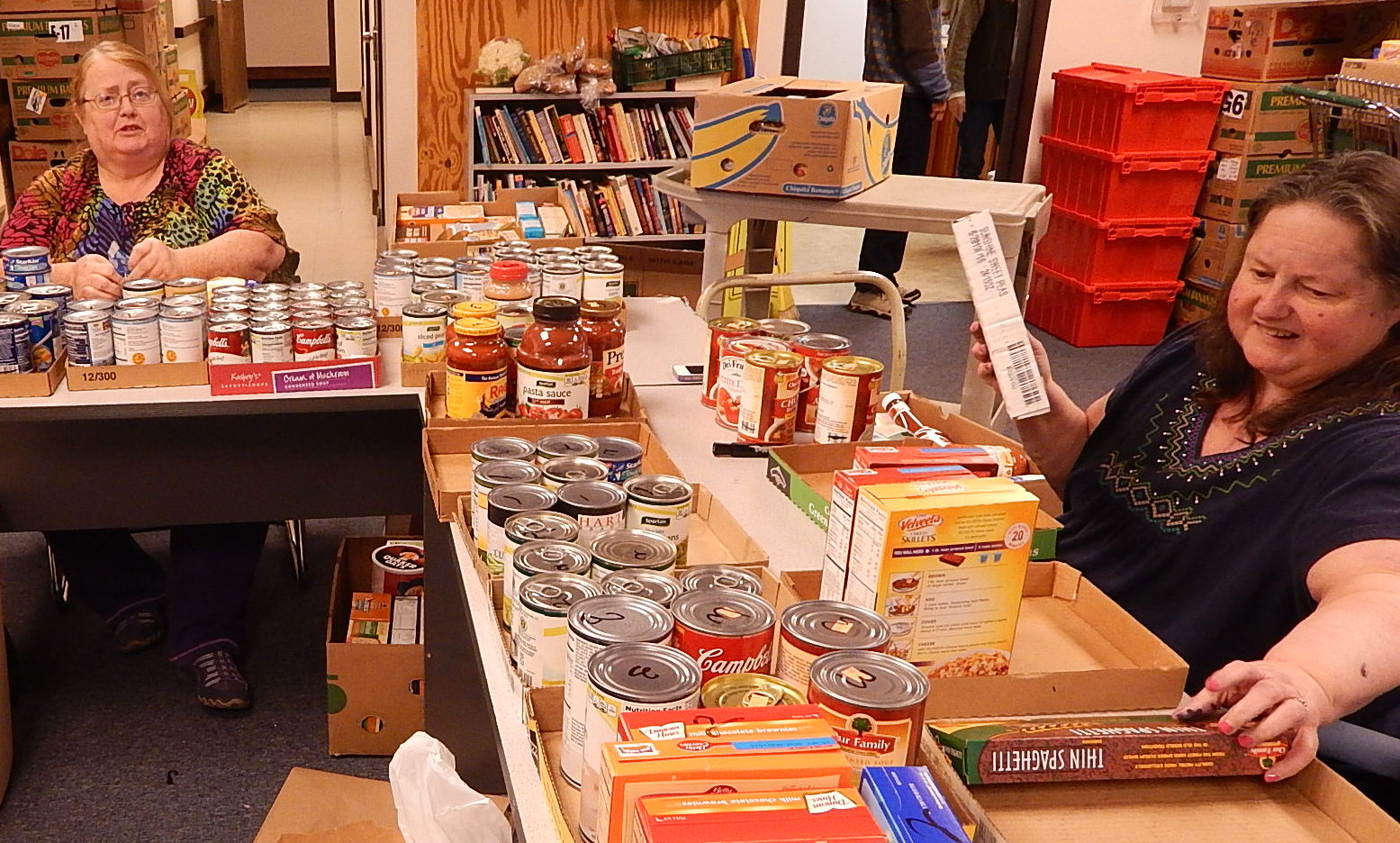 volunteers sorting food collected during Chase the Chill Food Drive.